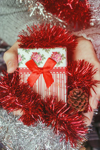Holding a christmas gift
