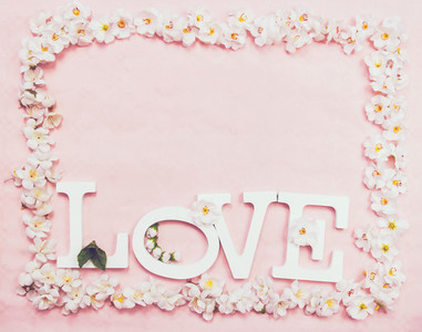 Word love and a floral frame