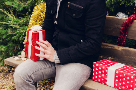 Young man and christmas gifts