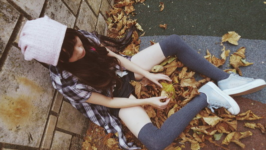 Young woman touching leaves