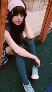 Young sad woman in a park