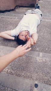 Young man lying on floor