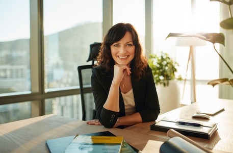 Beautiful female executive in modern office