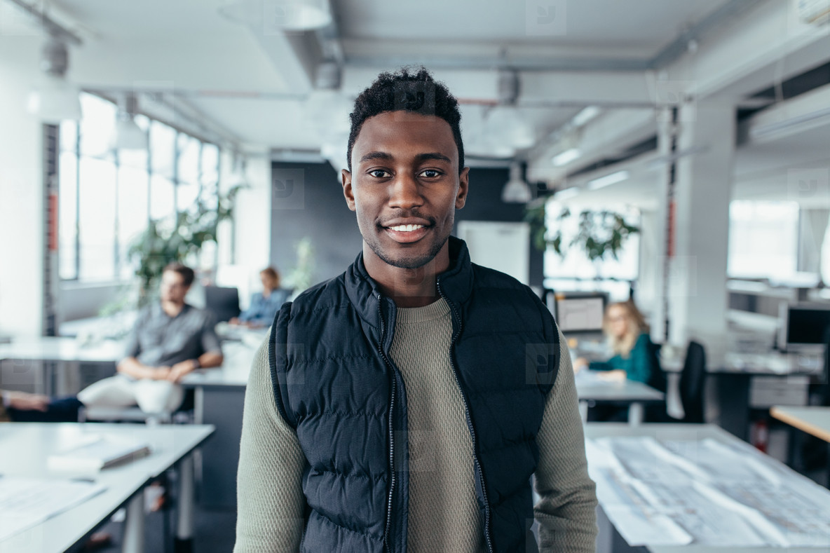 African male designer standing in modern office