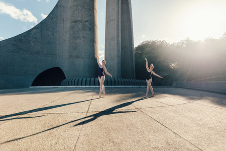 Female ballet dancers practicing duet dance
