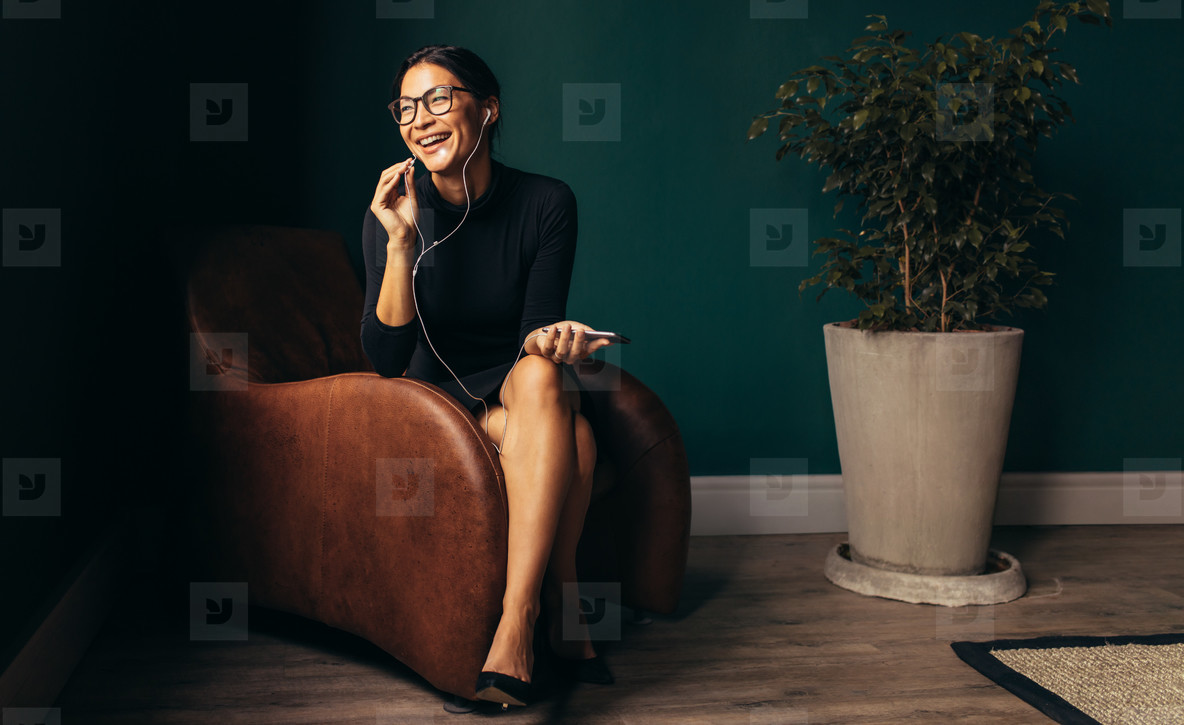 Smiling young businesswoman talking on phone