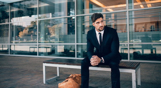 Business traveler waiting outside at airport