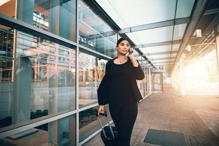 Female traveler making phone call