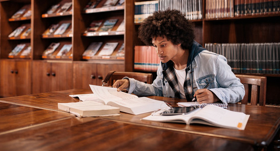 Young afro american student preparing for exam