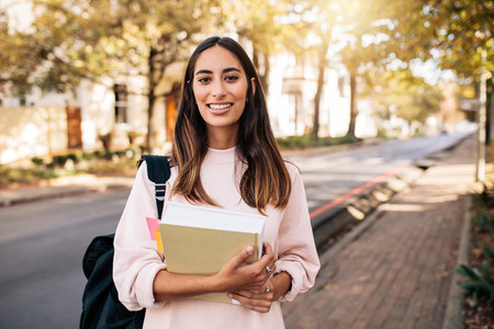 Female university student with book in campus