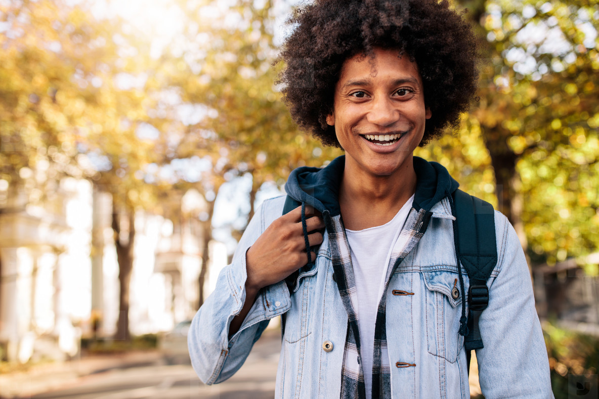 Young man with backpack going to school college