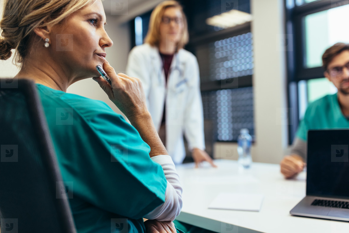 Female medical professional in staff meeting