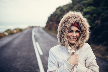 Beautiful smiling woman on open highway