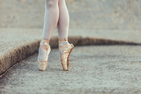 Close up of legs of ballet dancer on pointe