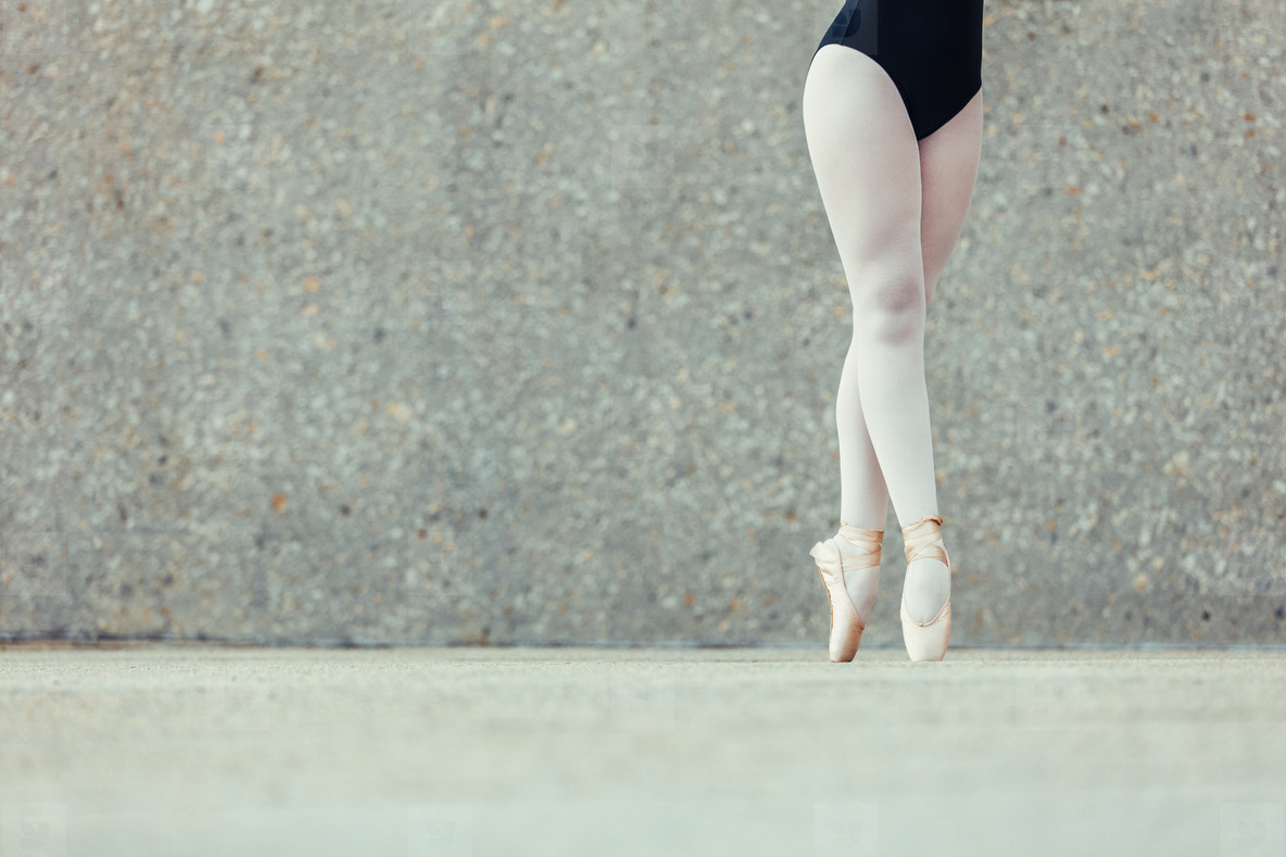 Closeup of legs of ballet dancer standing in pointes