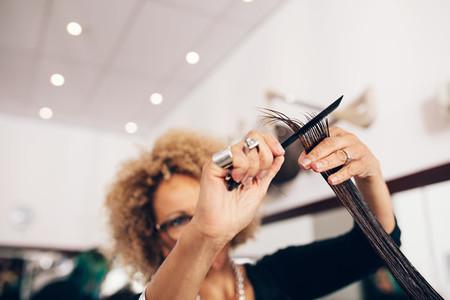 Female hair stylist cutting woman 039s hair at salon