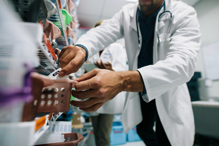 Doctor finding a medicine in hospital pharmacy