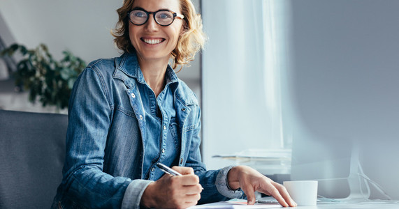Caucasian woman working at her desk in office