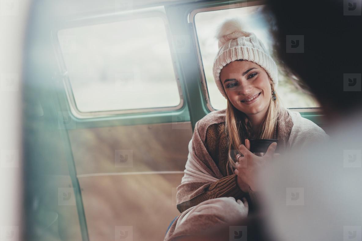 Beautiful woman travelling by van