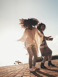 Friends dancing and enjoying on road trip