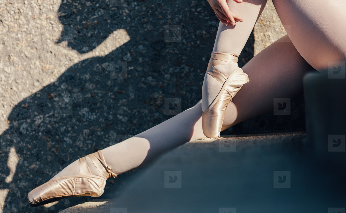 Close up of pointe shoes worn by female ballet dancer