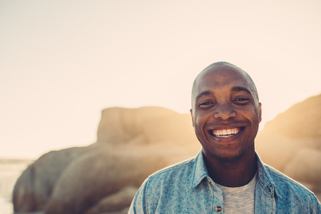 African man smiling on the beach