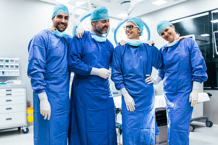 Successful surgeon team standing in operating room