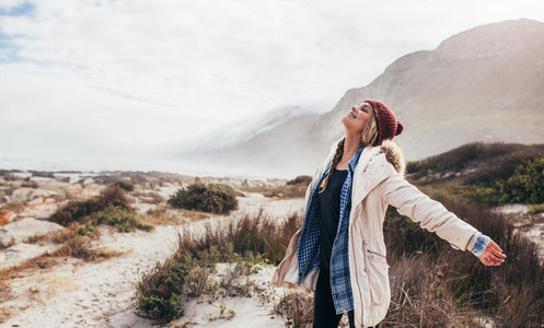 Woman happily breathing in the fresh sea air
