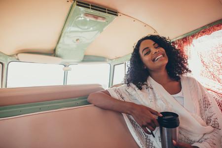 African woman enjoying on road trip
