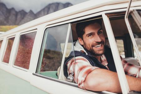 Smiling man driving a van