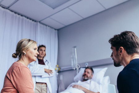 Family visiting hospitalised man