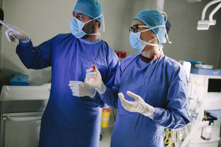 Surgeon looking at medical monitor during surgery