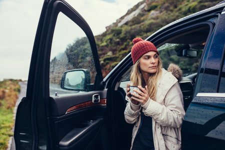 Female on road trip having coffee