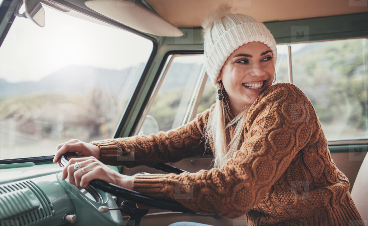 Beautiful woman enjoying her road trip