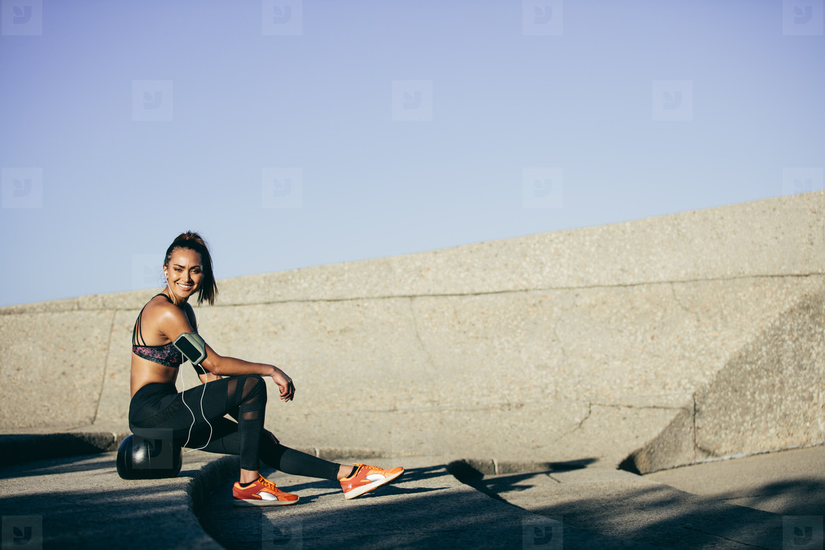 Woman resting on a fitness ball after workout