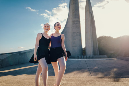 Female ballet dancers posing for photograph outdoors