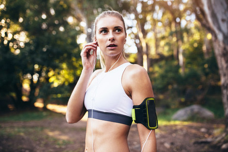 Female runner wearing earphones during workout
