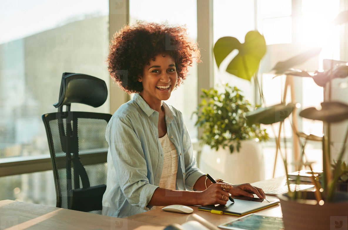 Afro american woman at her creative workplace