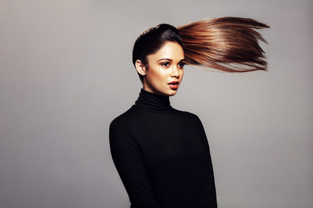 Beautiful woman with hair ponytail flying in air
