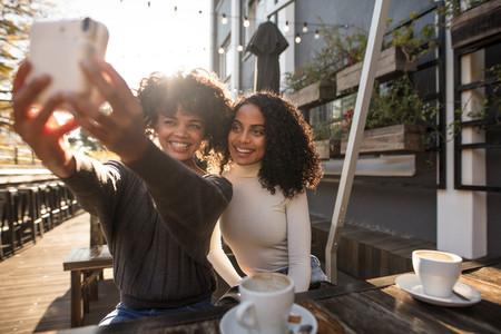 Two young women taking a selfie