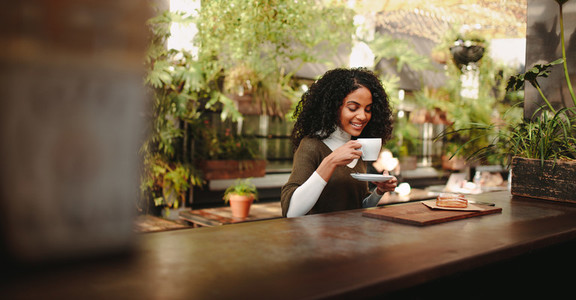 Woman enjoying coffee with breakfast