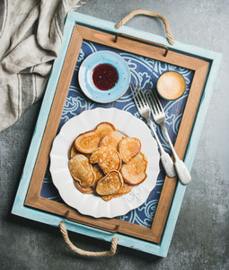 Breakfast tray with whole grain pancakes raspberry jam coffee espresso