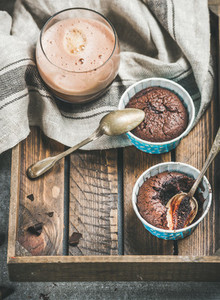 Chocolate souffle in baking cups and mocha coffee in glass