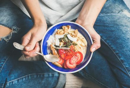 Yogurt granola seeds fresh dry fruits and honey in bowl