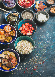 Ingredients for healthy vegetarian breakfast over dark blue plywood background