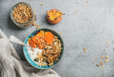 Oatmeal  quinoa gluten free granola  yogurt  dried fruit  seeds  honey  persimmon