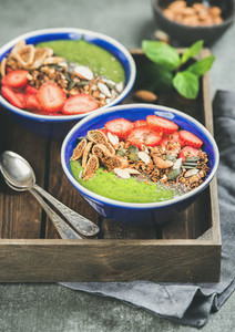 Green smoothie bowls with seeds  nuts  fruit and fresh berries