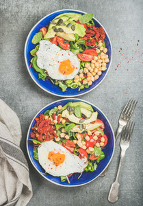 Clean eating concept breakfast with fried egg  chickpea  vegetables  seeds
