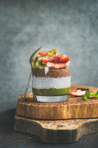 Healthy vegetarian breakfast concept in glass over wooden board