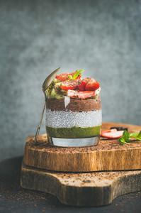 Healthy vegetarian breakfast concept in glass over wooden board
